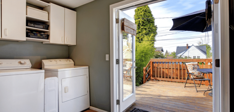 mud room with laundry that leads to outdoor patio